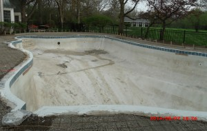 Pool drained and surface being prepared for a new one